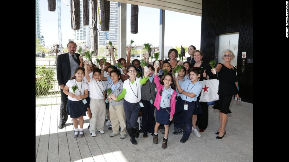 The museum has opened its doors to Miami-Dade schools to foster a broader appreciation and understanding of art.  Here, Jorge Pérez poses with a group of 3rd graders visiting the museum.