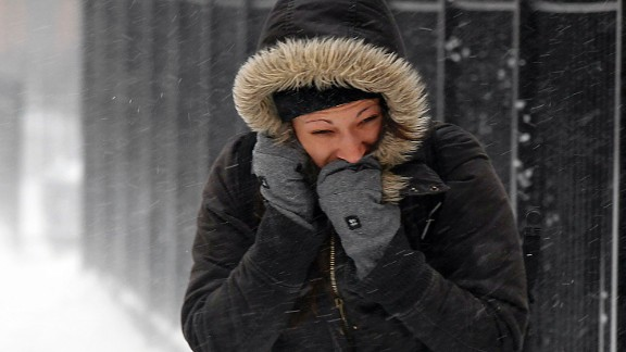 A woman fights the wind and snow in Chicago on February 5.