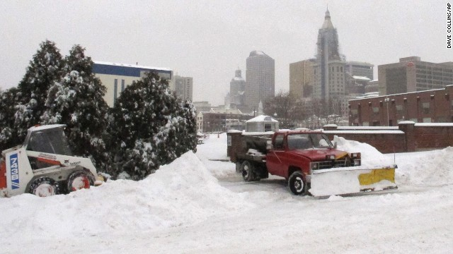 Crews clear snow as ice pellets fall in Hartford, Connecticut on February 5.