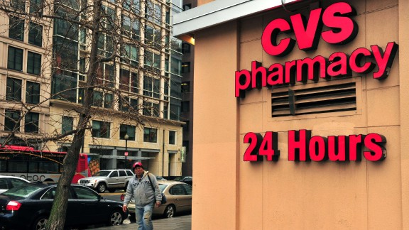 """A man passes a CVS drugstore February 5, 2014 in Washington, DC. The second largest US drugstore chain, CVS, announced Wednesday it will stop selling cigarettes by the end of the year, a decision President Barack Obama hailed as a """"powerful example.""""CVS said its 7,600 stores across the country will cease tobacco sales by October 1, despite the projected $2 billion loss the move will entail. AFP PHOTO / Karen BLEIERKAREN BLEIER/AFP/Getty Images"""