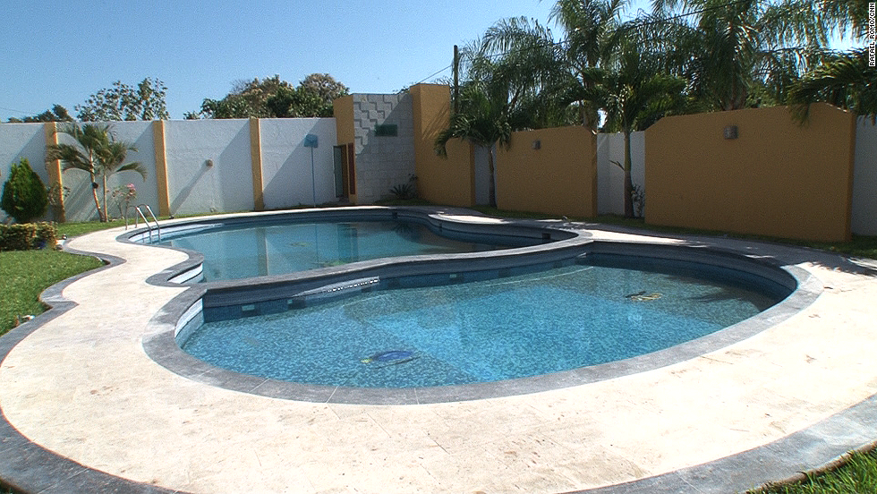 The seized property includes a two-level circular pool divided in the middle.