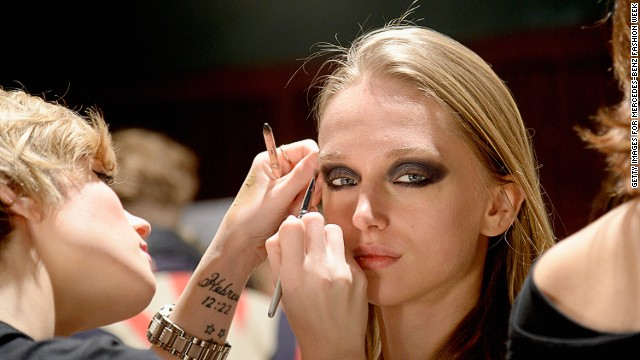 NEW YORK, NY - FEBRUARY 06: A model prepares backstage at Jay Godfrey Presentation during Mercedes-Benz Fashion Week Fall 2014 at The Hub at The Hudson Hotel on February 6, 2014 in New York City. (Photo by Fernanda Calfat/Getty Images For Mercedes-Benz Fashion Week)