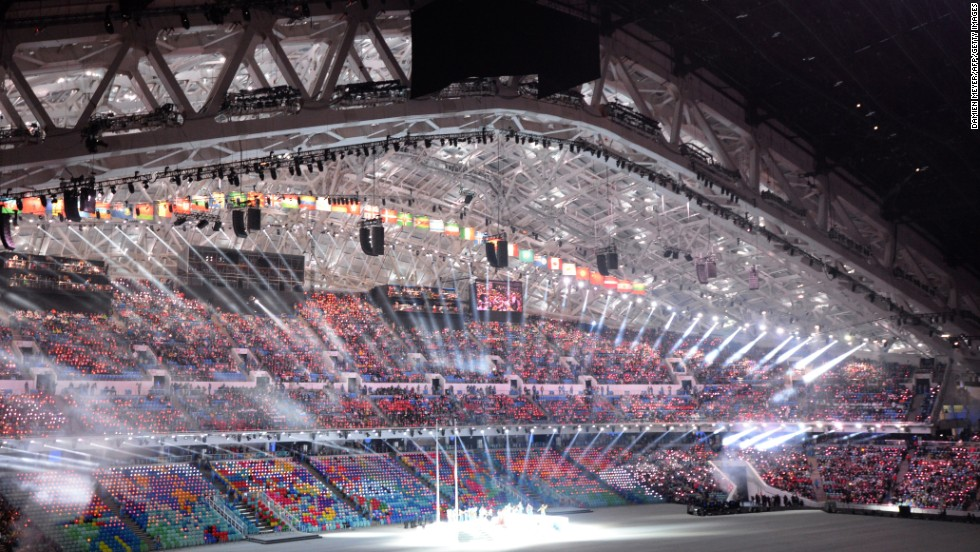 Performers take their places inside the packed stadium.