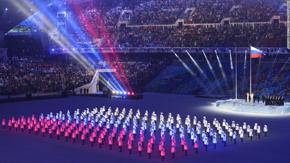 Performers' jackets light up to form the Russian flag.