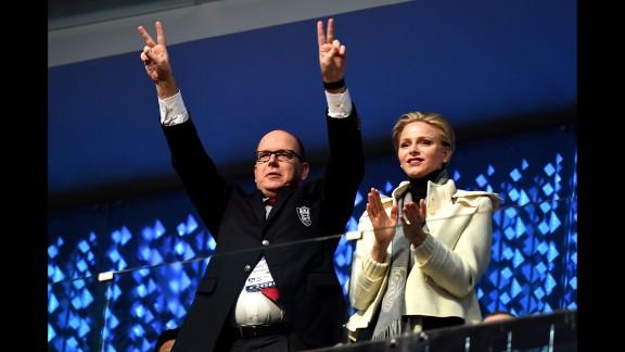 Prince Albert II and Princess Charlene of Monaco enjoy the atmosphere.