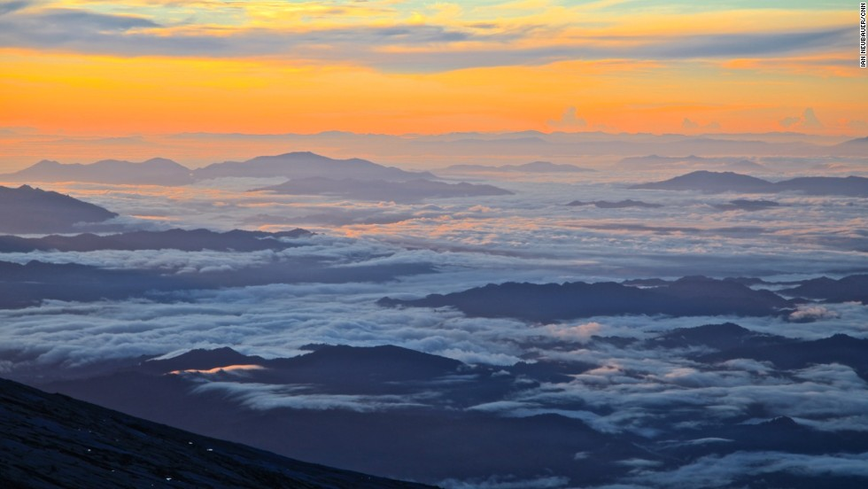 The sun rising over Malaysia's Sabah state, seen from the summit at Low's Peak on Mount Kinabalu.