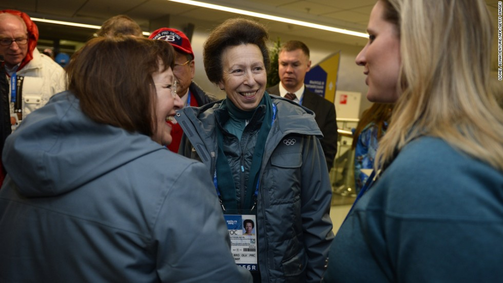 Britain's Princess Anne, center, talks with people upon arriving for the opening ceremony.