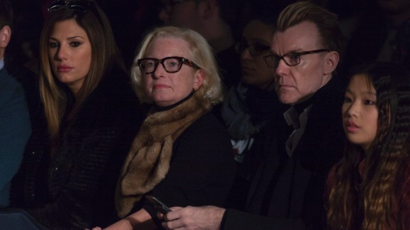 Daisy Fuentes and Neiman Marcus fashion director Ken Downing sit front row at Carmen Marc Valvo