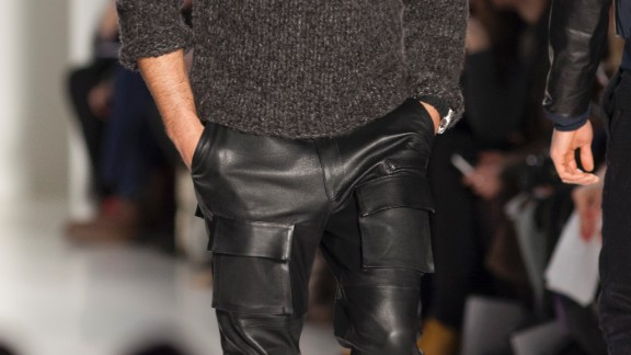 A model walks down the runway in leather pants for Nautica.