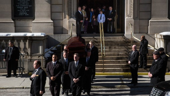 The casket carrying Oscar-winning actor Philip Seymour Hoffman leaves the Church of St. Ignatius Loyola after Hoffman's private funeral service Friday, February 7, in New York City. Hoffman, 46, was found dead in his Manhattan apartment February 1.