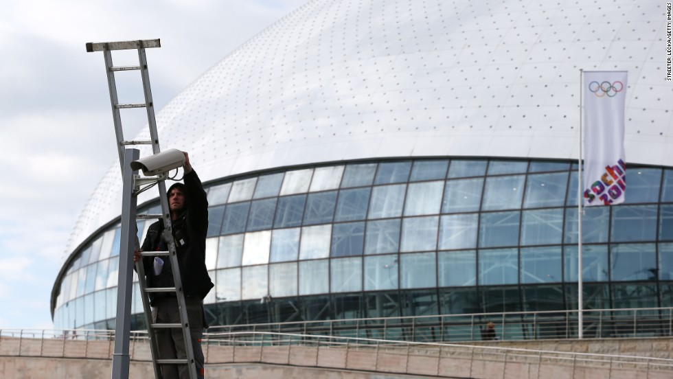 A worker repairs a security camera on February 4 outside the Bolshoy Ice Dome.