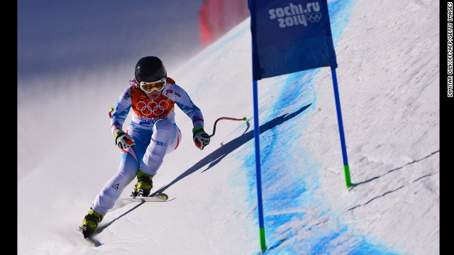 Austria's Nicole Schmidhofer takes part in a Women's Alpine Skiing Downhill training session at the Rosa Khutor Alpine Center on February 8, 2014, during the Sochi Winter Olympics.        AFP PHOTO / DIMITAR DILKOFF        (Photo credit should read DIMITAR DILKOFF/AFP/Getty Images)