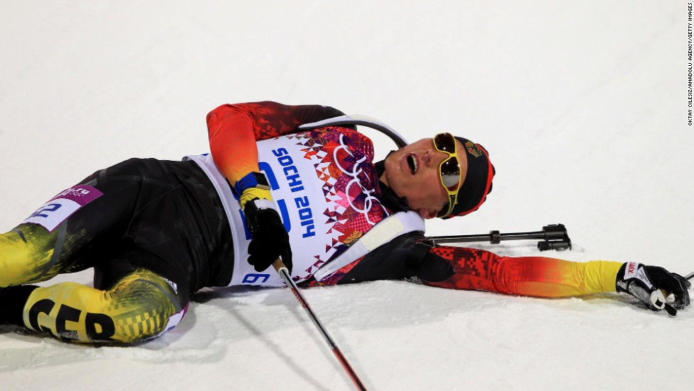 Tarjei Boe, a biathlete from Norway, falls to the ground after competing in the 10-kilometer sprint.