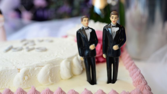 A wedding cake with a male couple is seen at The Abbey restaurant at a celebration of the over100 same-sex marriages performed today in West Hollywood, California, July 1 2013.. The U.S. Ninth Circuit Court of Appeals lifted California