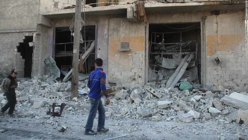 Syrians gather at a site hit by barrel bombs, allegedly dropped by a regime helicopter on the opposition-controlled Mesekin Hananu district of Aleppo on February 8.