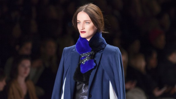 Rebecca Minkoff sends a model down the runway in a slew of navy tones and a belted fur stole.