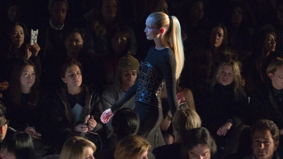 A model wears the signature bandage dress during the Herve Leger by Max Azria show on February 8. All the models sported sleek ponytails with a streak of  blue or coral.