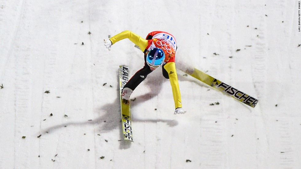Severin Freund of Germany crashes upon landing during the first round of the men's normal hill ski jumping event on Sunday, February 9.