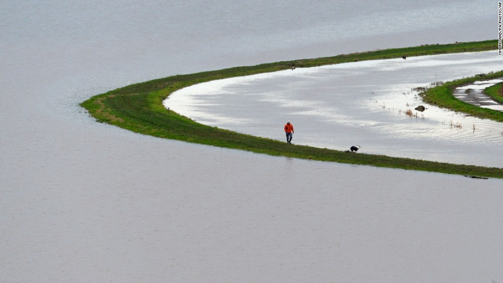 A man walks beside the River Tone near Burrowbridge, England, on Wednesday, January 29.