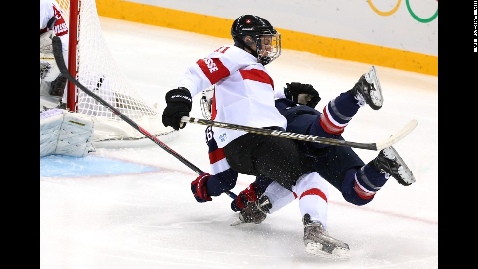 Swiss hockey player Angela Frautschi, left, clashes with Kendall Coyne of the United States during their game February 10.