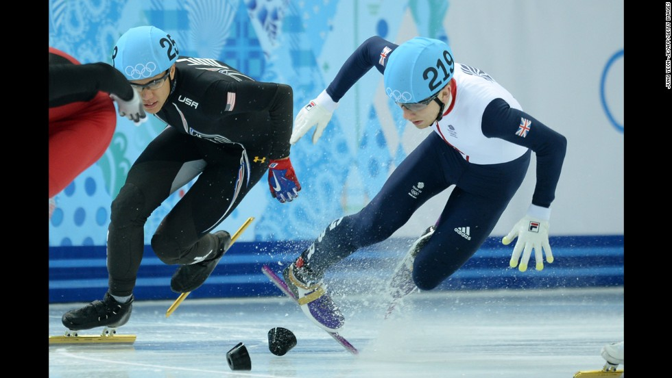 Great Britain's Jack Whelbourne, right, falls as he competes in the 1,500-meter short track final on February 10.