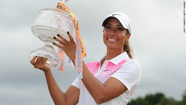 Cheyenne Woods hold the Australian Ladies Masters trophy aloft following her two-stroke victory on Australia's Gold Coast on Sunday.