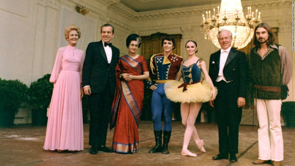 President Richard Nixon and his wife, Pat, pose with Indian Prime Minister Indira Gandhi and performers Edward Villella and Patricia McBride of the New York City Ballet, conductor Hugo Fiorato and guitarist William Schustick on November 4, 1971.