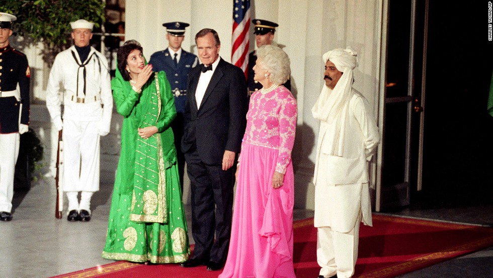 President George H.W. Bush and first lady Barbara Bush greet Pakistani Prime Minister Benazir Bhutto and her husband, Asif Zardiri, at the White House on June 6, 1989.
