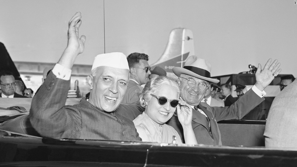 India's first Prime Minister Jawaharlal Nehru, left, Indian Ambassador to the U.S. and Nehru's sister Vijaya Pandit, and President Harry S. Truman, wave as they leave Washington's National Airport on October 11, 1949, after Nehru arrived from London. The state dinner for Nehru was held at Blair House, the government guest house across the street from the White House, because the Executive Mansion was undergoing repairs.