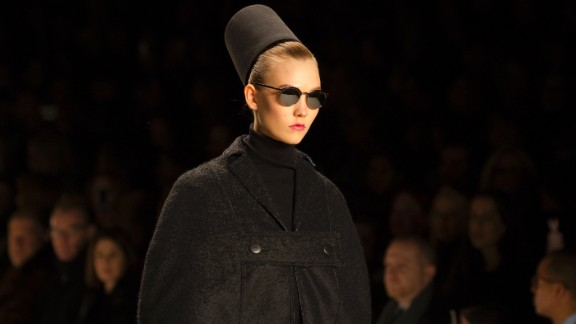 Karlie Kloss wore a fez down the runway for Carolina Herrera.
