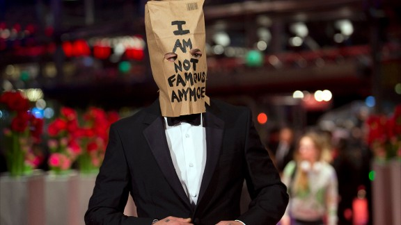 """Although LaBeouf didn't stay for """"Nymphomaniac's"""" media event, he did show up for the premiere wearing one eye-catching accessory: a paper bag over his head bearing his favorite phrase, """"I AM NOT FAMOUS ANYMORE,"""" scrawled in black marker."""