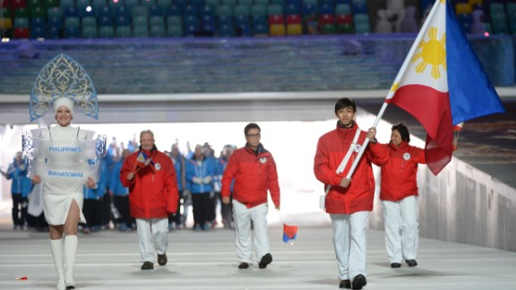 Philippines' flag bearer, Michael Christian Martinez, leads his national delegation during the Opening Ceremony of the 2014 Sochi Winter Olympics.