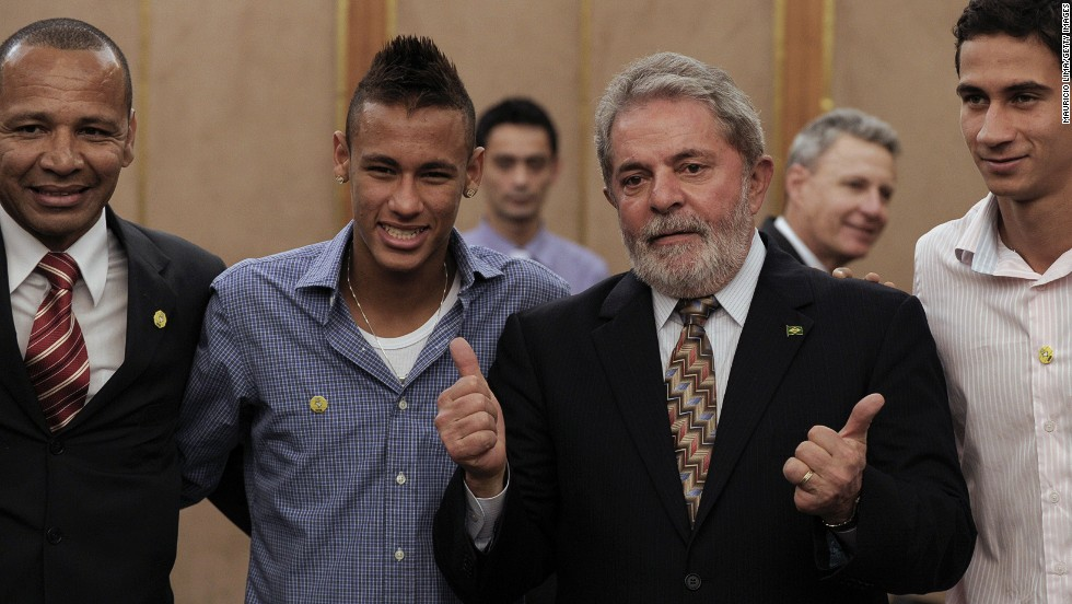 Neymar Senior, picture on the left, represents his son, seen here alongside former Brazil President Luiz Inacio Lula da Silva as well as his onetime playing partner at Santos, Paulo Henrique Ganso.