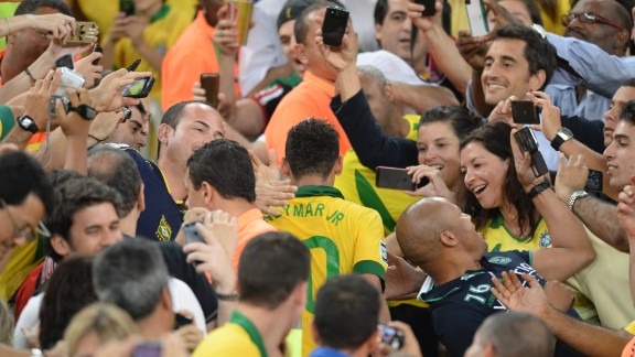 Neymar is mobbed by members of the public in Rio's Maracana after his starring role -- voted best player in addition to being top goalscorer -- during Brazil's Confederations Cup triumph on home soil last year.