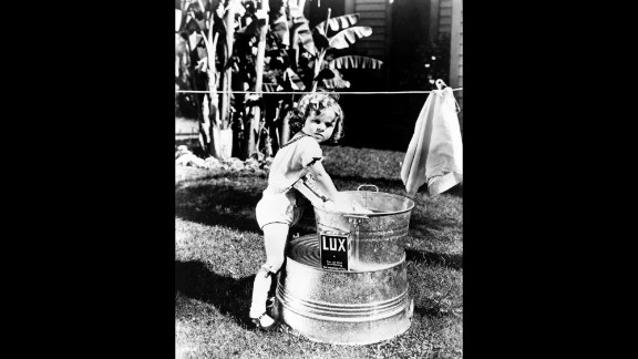 """Temple poses for a promotional photograph for one of the """"Baby Burlesks"""" series of short films, circa 1932."""