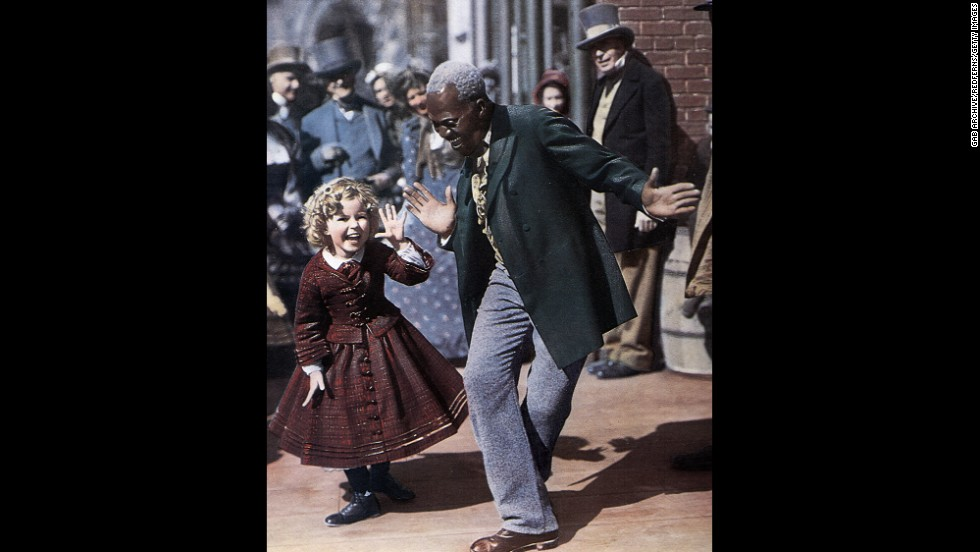 "Billy ""Bojangles"" Robinson and Shirley Temple dance together on set in 1935."
