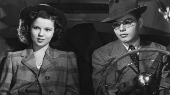 """Temple and Dickie Moore act in a scene from the film """"Miss Annie Rooney"""" in 1942."""