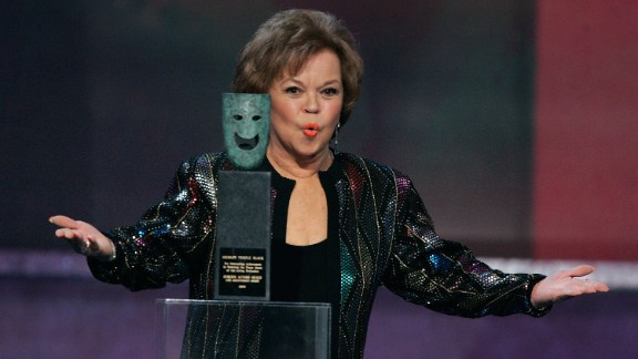 Temple Black accepts the Screen Actors Guild Life Achievement Award onstage during the awards show in 2006.