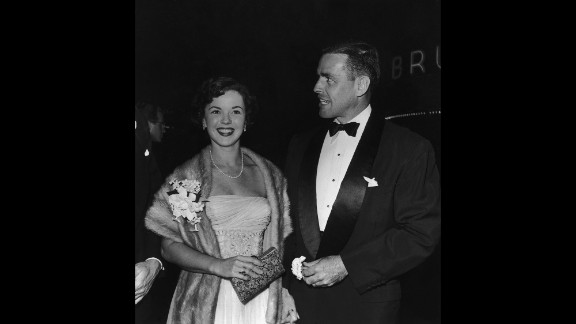 """Temple and her second husband, Charles Black, arrive at the premiere of """"Roman Holiday"""" in 1953."""