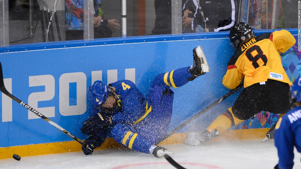 Sweden's Jenni Asserholt falls after missing a hit on Germany's Julia Zorn during their ice hockey match on February 11.