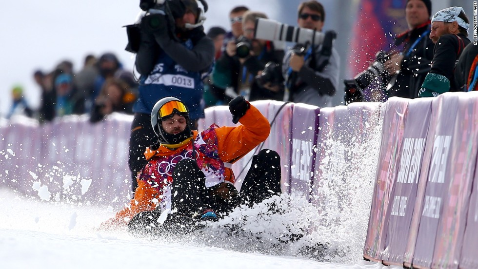 Snowboarder Dolf van der Wal of the Netherlands falls as he competes in the halfpipe on February 11.
