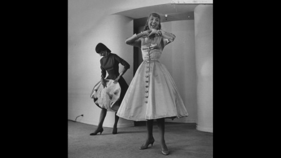 """The 1950s saw a return to a more feminine style, with designer Anne Fogarty (pictured) leading the way. """"Fogarty had the tiniest, tiniest waist, and made all these corseted dresses -- but also was a successful career woman herself,"""" said Arnold. """"It was a combination of being very 'housewifey' but also very powerful and dramatic."""""""