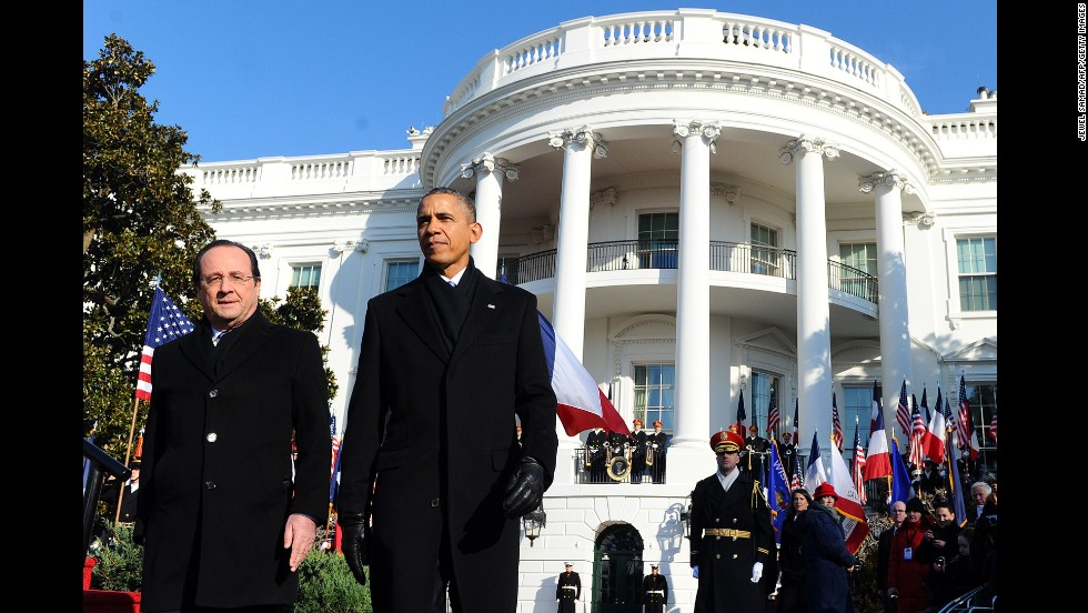 U.S. President Barack Obama escorts French President Francois Hollande for a review of the honor guard during a ceremony at the White House on Tuesday, February 11. Hollande's three-day state visit is designed to underscore historic ties and a burgeoning security relationship between America and its oldest ally.