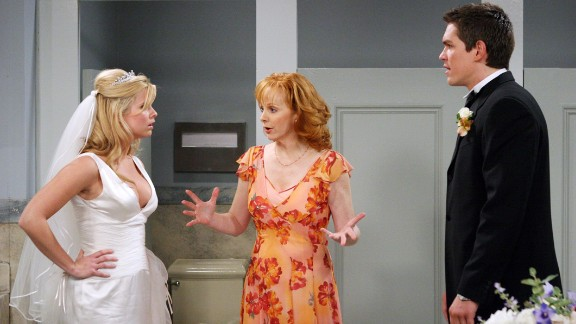 """Reba McEntire, center, as Reba Hart, who worked as a secretary and later, a real estate agent, in """"Reba."""""""