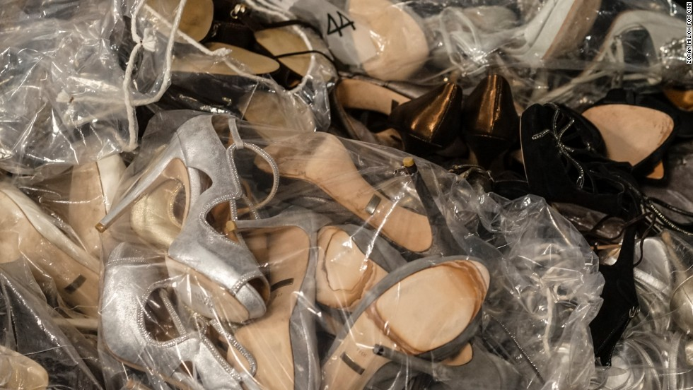 Packages of shoes in different styles and sizes are seen backstage at the Badgley Mischka show on February 11.