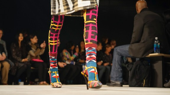 Socks were layered on top of tights for an extra layer of warmth -- and color! T-strap heels appeared in Libertine