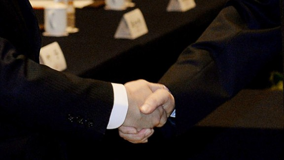 Taiwanese official Wang Yu-chi (L) who is in charge of the islands China policy shakes hands with his Chinese counterpart Zhang Zhijun from the Taiwan Affairs office (R) at the start of their meeting in Nanjing on February 11, 2014.