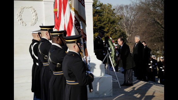 Hollande, with U.S. Secretary of Defense Chuck Hagel and Maj. Gen. Jeffrey S. Buchanan, commander of the U.S. Army Military District of Washington, lays a wreath at the Tomb of the Unknown Soldier at Arlington National Cemetery in Virginia. 2014 marks the 70th anniversary of the Allied Forces D-Day landing in Normandy, which helped lead to the liberation of France and the European continent.