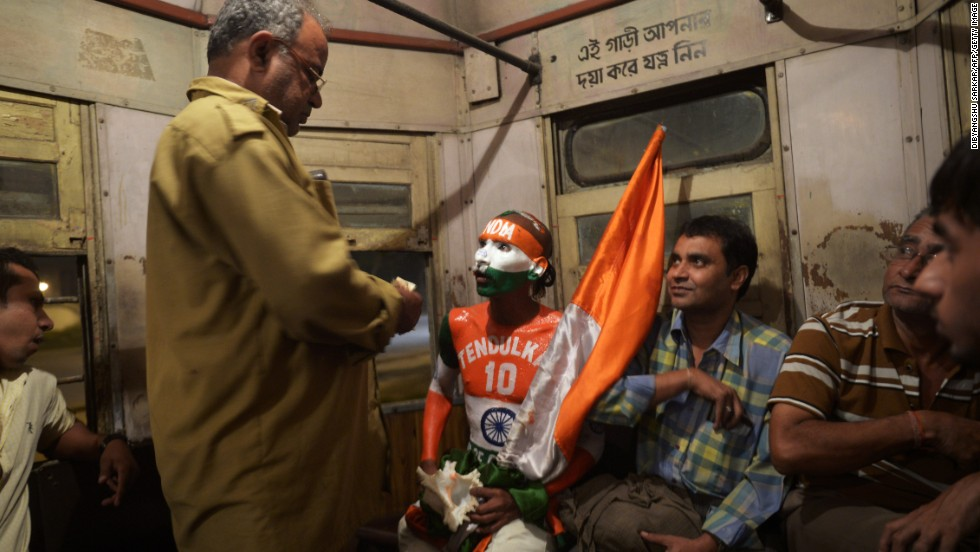 Sudhir Kumar Chaudhary, a fan of Tendulkar, is picturing riding a tram following a cricket match in Kolkata on November 8, 2013. Chowdhury attended more than 300 international matches and is widely recognized for showing up at every home match the Indian team plays, with his entire body painted in the national colors of India.