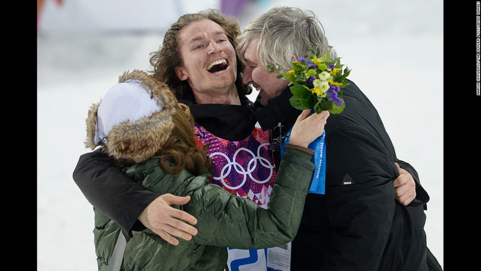 Swiss snowboarder Iouri Podladtchikov celebrates with his parents, Yurii and Valentina, after winning gold in the halfpipe on February 11.